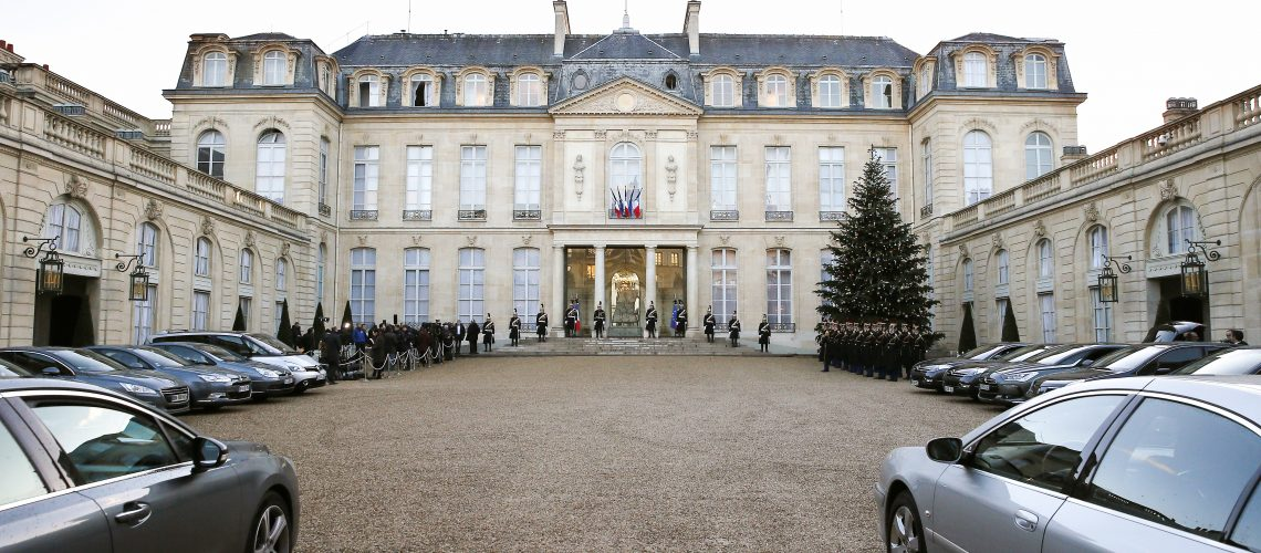 A French flag is flown at half-mast at the Elysee Palace in Paris on January 8, 2015,  as France honoured the 12 people massacred at Charlie Hebdo magazine. Elite French security forces tightened the net on two brothers suspected of slaughtering 12 people in an Islamist attack after discovering an abandoned getaway car in a northeastern town. Helicopters buzzed overhead as police mounted a frantic manhunt for the two fugitives thought to be behind the bloodbath at Charlie Hebdo magazine in Paris, the worst terrorist attack in France for half a century. AFP PHOTO / PATRICK KOVARIK
