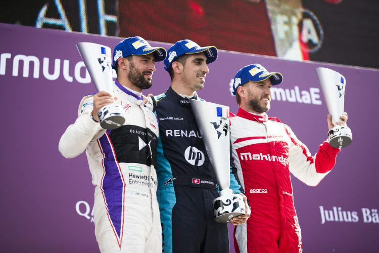 2016/2017 FIA Formula E Championship. Qatar Airways Paris ePrix, France. Saturday 20 May 2017. Jose Maria Lopez (ARG), DS Virgin Racing, Spark-Citroen, Virgin DSV-02, Sebastien Buemi (SUI), Renault e.Dams, Spark-Renault, Renault Z.E 16, and Nick Heidfeld (GER), Mahindra Racing, Spark-Mahindra, Mahindra M3ELECTRO, celebrates on the podium. Photo: Sam Bloxham/LAT/Formula E ref: Digital Image _W6I9674