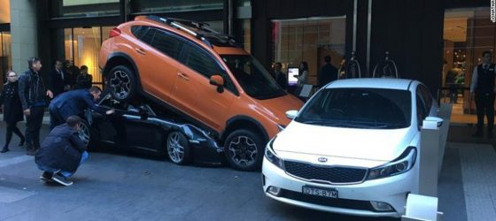 A worker at a hotel valet in Sydney, Australia wedged a Porsche under the SUV parked in front of it and rammed a second parked car against a row of metal bollards.